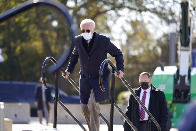 Democratic presidential candidate former Vice President Joe Biden arrives to speak at a rally at the Iowa State Fairgrounds in Des Moines, Iowa, Friday, Oct. 30, 2020. (AP Photo/Andrew Harnik)