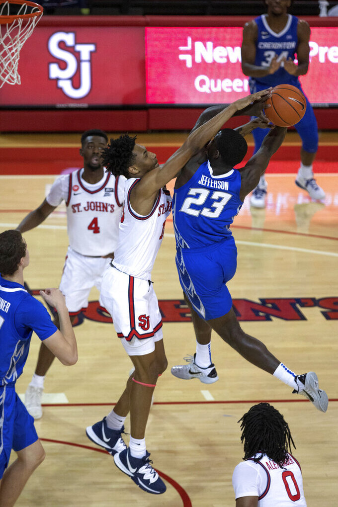 St. John's forward Isaih Moore blocks Creighton forward Damien Jefferson (23) in the first half of an NCAA college basketball game Thursday, Dec. 17, 2020, in New York. (AP Photo/Kevin Hagen)