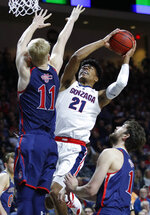 Gonzaga's Rui Hachimura shoots around St. Mary's Matthias Tass, left, and St. Mary's Jordan Hunter during the first half of an NCAA college basketball game for the West Coast Conference men's tournament title, Tuesday, March 12, 2019, in Las Vegas. (AP Photo/John Locher)
