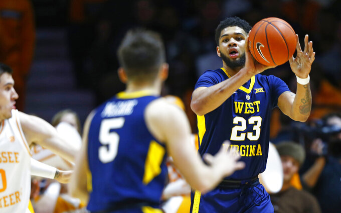 West Virginia forward Esa Ahmad (23) passes the ball to guard Jordan McCabe (5) in the first half of an NCAA college basketball game against Tennessee, Saturday, Jan. 26, 2019, in Knoxville, Tenn. (AP Photo/Wade Payne)