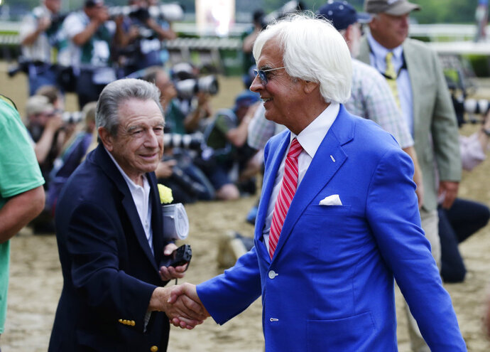 Justify's trainer Bob Baffert is congratulated after Justify won the 150th running of the Belmont Stakes horse race and the Triple Crown, Saturday, June 9, 2018, in Elmont, N.Y. (AP Photo/Frank Franklin II)