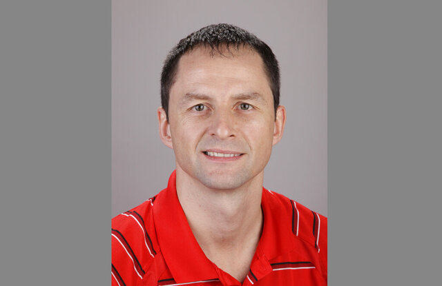 FILE - In this Dec. 15, 2011, file photo, Houston Rockets director of global scouting Arturas Karnisovas poses during the NBA basketball team's media day in Houston. The Bulls hired Denver Nuggets general manager Karnisovas to run their basketball operation, a person familiar with the situation said Thursday night, April 9, 2020. The person, who confirmed reports by several outlets, spoke on the condition of anonymity because the move has not been announced. Longtime executive John Paxson was expected to move into an advisory role. (AP Photo/David J. Phillip, File)
