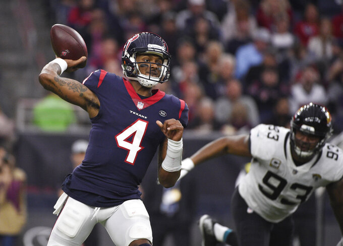 FILE - In this Dec. 30, 2018, file photo, Houston Texans quarterback Deshaun Watson (4) throws a pass against the Jacksonville Jaguars during the first half of an NFL football game in Houston. Watson will make his playoff debut on Saturday against the Indianapolis Colts in his second year in the NFL. (AP Photo/Eric Christian Smith, File)
