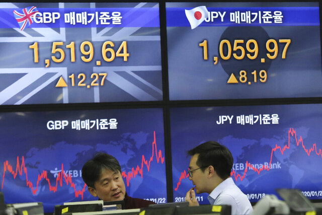Currency traders work at the foreign exchange dealing room of the KEB Hana Bank headquarters in Seoul, South Korea, Wednesday, Jan. 22, 2020. Shares advanced in early Asian trading after a slide in U.S. stocks Tuesday as a virus outbreak in China rattled global markets. (AP Photo/Ahn Young-joon)