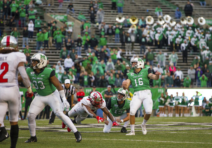 Marshall kicker Justin Rohrwasser (16) hits a 53-yard winning field goal against Western Kentucky during an NCAA college football game Saturday, Oct. 26, 2019, in Huntington, W.Va. (Sholten Singer/The Herald-Dispatch via AP)