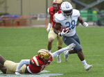 The Citadel's Nkem Njoku avoids VMI defensive back Alex Oliver's during an NCAA college football game Saturday, April 17, 2021, in Lexington, Va. (David Hungate/Roanoke Times via AP)