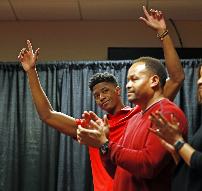 Texas Tech's Jarrett Culver, left, gestures after declaring to enter the NBA basketball draft while surrounded by his family during a news conference, Thursday, April 18, 2019, in Lubbock, Texas. (Brad Tollefson/Lubbock Avalanche-Journal via AP)