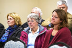 The family of victim Donnivan Schaeffer listens to a description of Charles Rhines' last words,