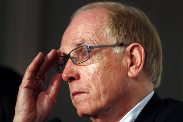 FILE - In this Friday Dec. 9, 2016 file photo, World Anti-Doping Agency investigator Richard McLaren speaks during a press conference in London. An investigation into the International Weightlifting Federation has found doping cover-ups and millions of dollars in missing money, lead investigator Richard McLaren said Thursday June 4, 2020. (AP Photo/Kirsty Wigglesworth, file)