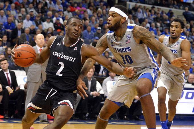 Cincinnati guard Keith Williams (2) drives against Memphis forward Mike Parks Jr. (10) in the second half of an NCAA college basketball game Thursday, Feb. 7, 2019, in Memphis, Tenn. (AP Photo/Brandon Dill)