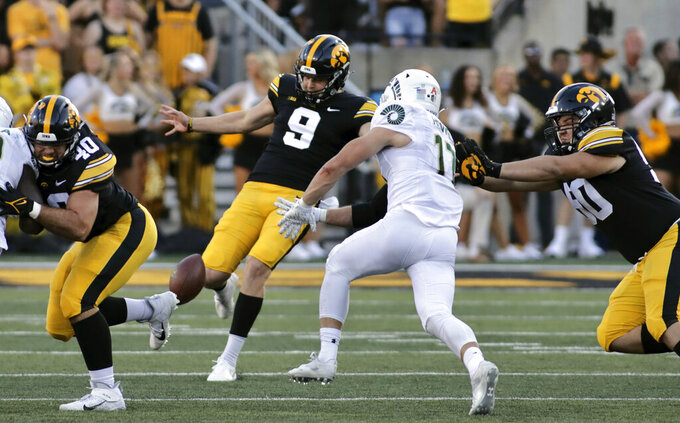 Colorado State defensive back Jack Howell (17) rushes Iowa punter Tory Taylor (9) during the second half of an NCAA college football game, Saturday, Sept. 25, 2021, in Iowa City, Iowa. (AP Photo/Ron Johnson)
