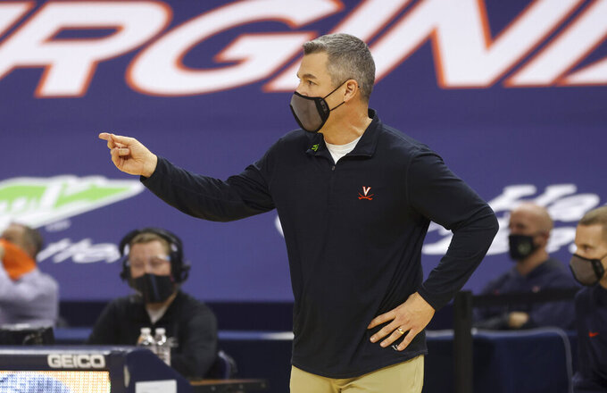Virginia coach Tony Bennett calls a play during the team's NCAA college basketball game against North Carolina on Saturday, Feb. 13, 2021, in Charlottesville, Va. (Andrew Shurtleff/The Daily Progress via AP, Pool)