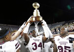 Mississippi State players celebrate after a 35-3 win over Mississippi in an NCAA college game for the Egg Bowl, in Oxford, Miss., Thursday, Nov. 22, 2018. (AP Photo/Rogelio V. Solis)
