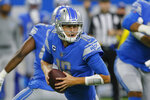 Detroit Lions quarterback Jared Goff rolls out to pass against the San Francisco 49ers In the first half of an NFL football game in Detroit, Sunday, Sept. 12, 2021. (AP Photo/Duane Burleson)