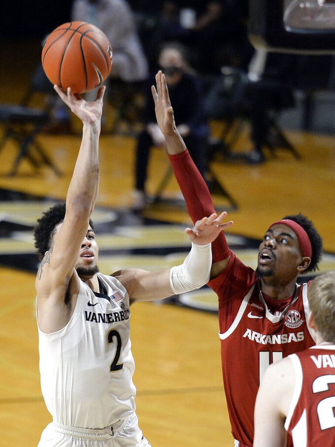 Vanderbilt guard Scotty Pippen Jr. (2) shoots against Arkansas guard Jalen Tate (11) during the first half of an NCAA college basketball game Saturday, Jan. 23, 2021, in Nashville, Tenn. (AP Photo/Mark Zaleski)