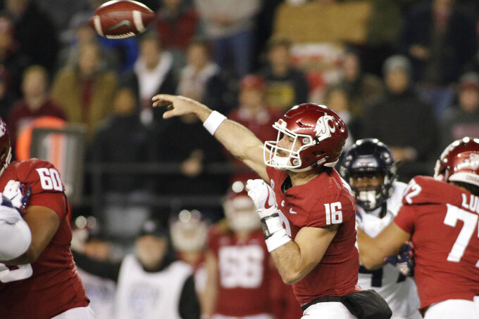 Washington State quarterback Gardner Minshew II (16) throws a pass during the first half of the team's NCAA college football game against Arizona in Pullman, Wash., Saturday, Nov. 17, 2018. (AP Photo/Young Kwak)