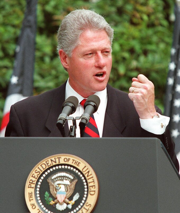 FILE - In this Aug. 22, 1996, file photo President Clinton talks in the Rose Garden of the White House  prior to signing legislation overhauling America's welfare system. (AP Photo/J.Scott Applewhite, File)