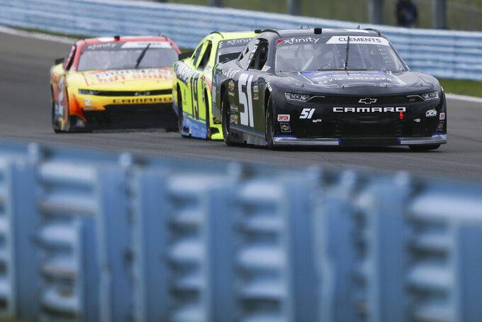 Jeremy Clements, right, Brandon Jones, center, and Myatt Snider, left, drive through the Esses in the NASCAR Xfinity Series auto race at Watkins Glen International in Watkins Glen, N.Y., on Saturday, Aug. 7, 2021. (AP Photo/Joshua Bessex)
