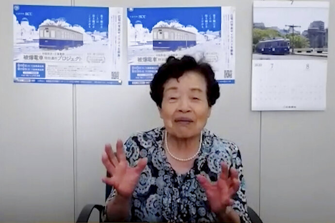 In this image made from video, Tetsuko Shakuda speaks during a video interview in Hiroshima, western Japan, Monday, Aug. 3, 2020. Shakuda was a frightened 14-year-old when she resumed her work as a conductor on a tram line in the devastated city of Hiroshima, just three days after the atomic bomb exploded 75 years ago, badly damaging the tracks and most of the trams. The U.S. first atomic bomb that exploded on Aug. 6, 1945, changed everything. As that first tram on Aug. 9 moved through Hiroshima, it passed huge piles of rubble and decomposing bodies. (AP Photo)