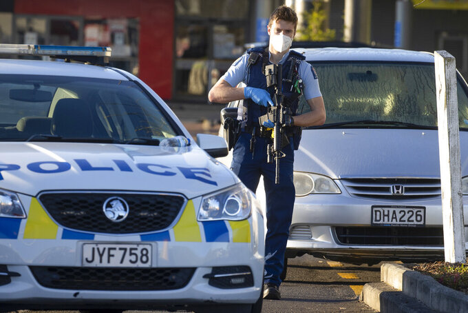 Armed police stand outside a supermarket in Auckland, New Zealand, Saturday, Sept. 4, 2021. New Zealand authorities say they shot and killed a violent extremist, Friday Sept. 3, after he entered a supermarket and stabbed and injured six shoppers. Prime Minister Jacinda Ardern described Friday's incident as a terror attack. (AP Photo/Brett Phibbs)