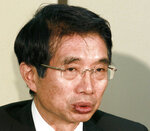 """In this March 2012, photo, lawyer Junichiro Hironaka speaks at the press cub of courthouse in Tokyo. The newly appointed star defender for former Nissan chairman Carlos Ghosn said Wednesday, Feb. 20, 2019 he believes the case against his client does """"not meet international standards."""" Hironaka also said that he believed Ghosn's trial on charges of falsifying financial reporting and breach of trust might not begin until after the summer. (Kyodo News via AP)"""