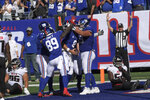New York Giants quarterback Daniel Jones (8) celebrates with his teammates after scoring a two-point conversion during the second half of an NFL football game against the Atlanta Falcons, Sunday, Sept. 26, 2021, in East Rutherford, N.J. (AP Photo/Bill Kostroun)