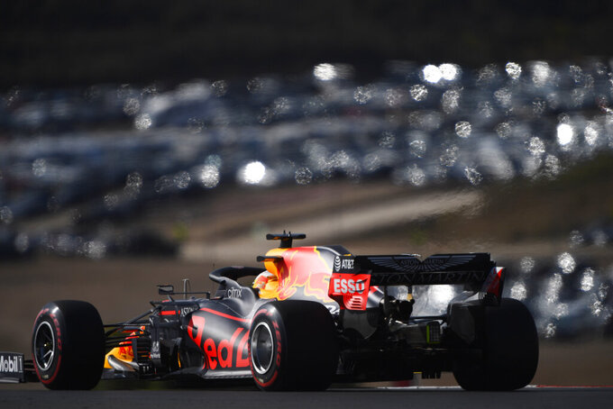 Red Bull driver Max Verstappen of the Netherlands steers his car during the qualifying session for the Formula One Portuguese Grand Prix at the Algarve International Circuit in Portimao, Portugal, Saturday, Oct. 24, 2020. The Formula One Portuguese Grand Prix will take place on Sunday. (Rudy Carezzevoli, Pool via AP)