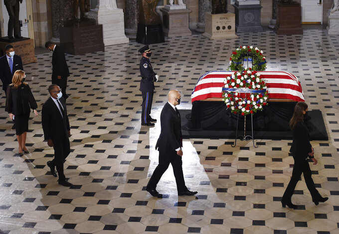 Mourners walk past the flag-draped casket of Justice Ruth Bader Ginsburg as it lies in state at the U.S. Capitol, Friday, Sept. 25, 2020, in Washington. (Olivier Douliery/Pool via AP)