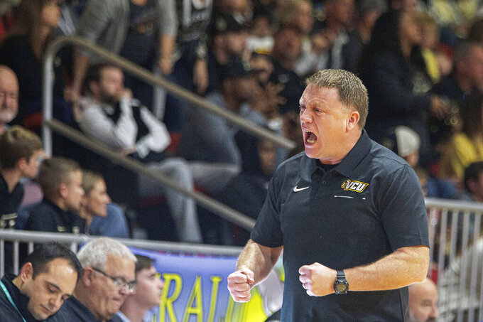 Virginia Commonwealth coach Mike Rhoades reacts during the second half of the team's NCAA college basketball game against Virginia Commonwealth at the Emerald Coast Classic in Niceville, Fla., Friday, Nov. 29, 2019. Purdue won  59-56. (AP Photo/Mark Wallheiser)
