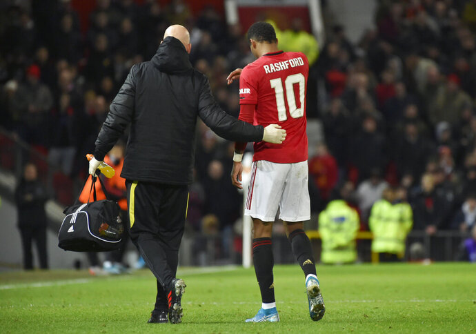 Manchester United's substitute player Marcus Rashford walks off the pitch with an injury during the English FA Cup third round replay soccer match between Manchester United and Wolverhampton Wanderers at Old Trafford in Manchester, England, Wednesday, Jan. 15, 2020. (AP Photo/Rui Vieira)
