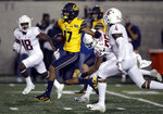 California's Makai Polk (17) evades the tackle of Washington State's Skyler Thomas (25) on his touchdown run in the second half of an NCAA college football game Saturday, Nov. 9, 2019, in Berkeley, Calif. (AP Photo/Ben Margot)