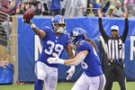 New York Giants' Elijhaa Penny, left, celebrates recovering a blocked punt for a touchdown during the first half of an NFL football game against the Arizona Cardinals, Sunday, Oct. 20, 2019, in East Rutherford, N.J. (AP Photo/Bill Kostroun)