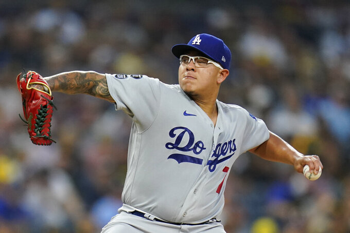 Los Angeles Dodgers starting pitcher Julio Urias works against a San Diego Padres batter during the first inning of a baseball game Tuesday, Aug. 24, 2021, in San Diego. (AP Photo/Gregory Bull)