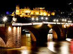 In this Tuesday, Dec. 4, 2018 photo the Old Bridge and the castle in background are seen on the way to the traditional Christmas market in Heidelberg, Germany. The Christmas market In the Old Town of Heidelberg underneath the famous castle is one of most picturesque christmas markets in southern Germany.  (AP Photo/Michael Probst)