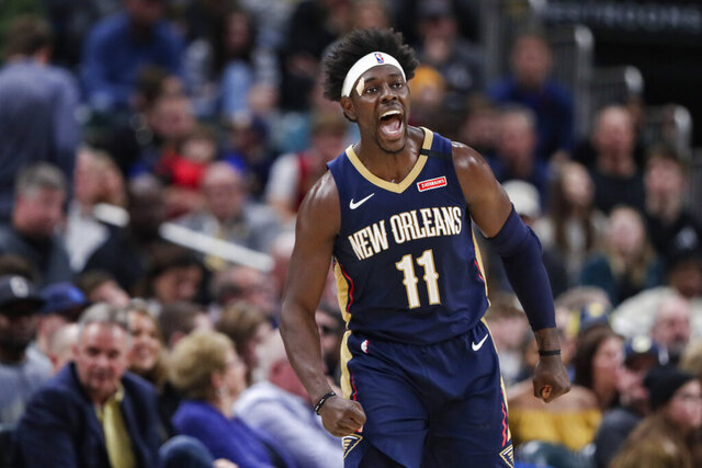 New Orleans Pelicans guard Jrue Holiday celebrates a 3-point basket late in the second half of the team's NBA basketball game against the Indiana Pacers in Indianapolis, Saturday, Feb. 8, 2020. The Pelicans won 124-117. (AP Photo/Michael Conroy)