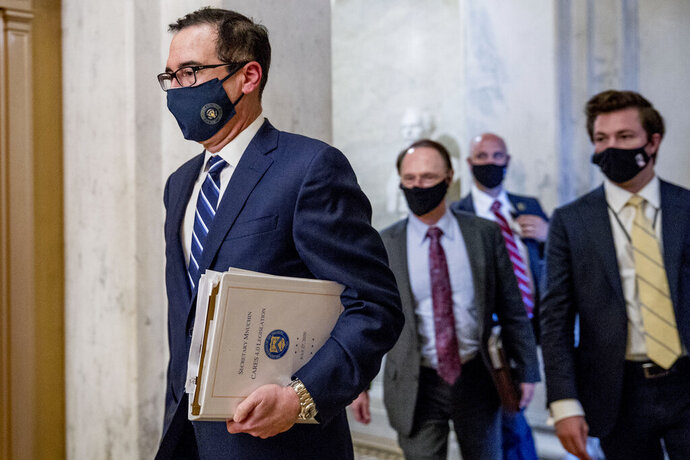 Treasury Secretary Steven Mnuchin, left, leaves a meeting with Senate Majority Leader Mitch McConnell of Ky. as negotiations continue on a coronavirus relief package on Capitol Hill in Washington, Tuesday, Aug. 4, 2020. (AP Photo/Andrew Harnik)