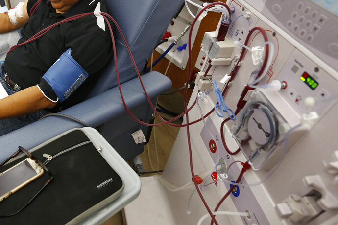 FILE - In this Monday, Sept. 24, 2018 file photo, a patient undergoes dialysis at a clinic in Sacramento, Calif. Results of a study released on Sunday, April 14, 2019 show that the diabetes drug Invokana has been shown to help prevent or delay worsening of kidney disease, which causes millions of deaths each year and requires hundreds of thousands of people to use dialysis to stay alive. (AP Photo/Rich Pedroncelli)