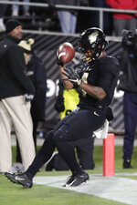Purdue wide receiver Rondale Moore (4) celebrates after scoring a touchdown against Ohio State during the first half of an NCAA college football game in West Lafayette, Ind., Saturday, Oct. 20, 2018. (AP Photo/Michael Conroy)