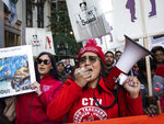 FILE - In this Oct. 14, 2019 file photo, members of the Chicago Teachers Union and SEIU Local 73 march through the Loop after a rally, three days before the unions could walk off the job on strike. Chicago's public schools have canceled classes after the teachers' union president announced that his bargaining team will recommend teachers vote to go on strike. Mayor Lori Lightfoot said Wednesday, Oct. 16, 2019, that classes would be canceled Thursday after determining that she can't accept the Chicago Teachers Union's demands, which she says would cost the city $2.5 billion it can't afford. (Ashlee Rezin Garcia/Chicago Sun-Times via AP)