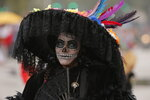 A woman dressed as a Catrina participates in the Day of the Dead parade in Mexico City, Saturday, Nov. 2, 2019. (AP Photo/Ginnette Riquelme)
