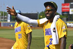 Cleveland Browns wide receiver Jarvis Landry waives to the crowd before the Jarvis Landry Celebrity Softball game, Saturday, June 12, 2021, in Eastlake, Ohio. (AP Photo/David Dermer)