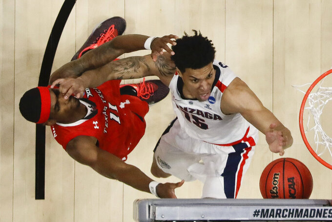 Texas Tech forward Tariq Owens, left, and Gonzaga forward Brandon Clarke vie for a rebound during the first half of the West Regional final in the NCAA men's college basketball tournament Saturday, March 30, 2019, in Anaheim, Calif. (AP Photo/Marcio Jose Sanchez)