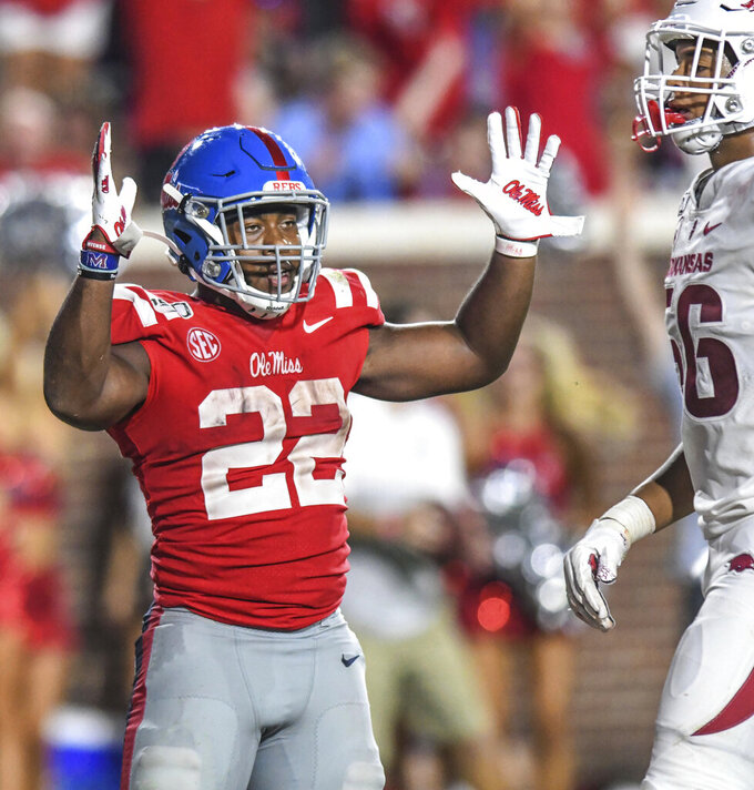 Mississippi running back Scottie Phillips (22) celebrates his fourth-quarter touchdown against Arkansas during an NCAA college football game Saturday, Sept. 7, 2019, in Oxford, Miss. (Bruce Newman/The Oxford Eagle via AP)