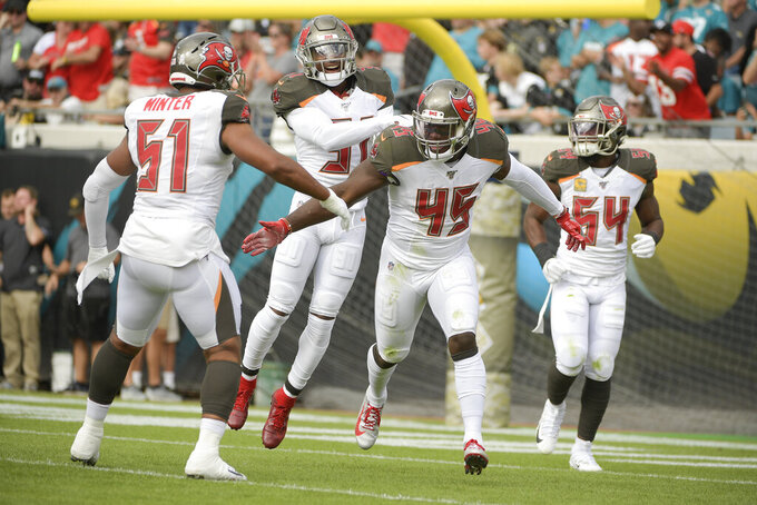 Buccaneers have defensive building blocks in White, Barrett