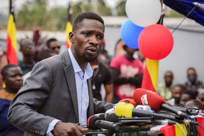 "Ugandan opposition figure Bobi Wine, whose real name is Kyagulanyi Ssentamu, speaks at a press conference in Kampala, Uganda Monday, Feb. 22, 2021. Wine says he will withdraw a legal petition that sought to overturn the victory of President Yoweri Museveni in last month's presidential election, charging that Uganda's courts are filled with ""yes-men"" appointed by Museveni and that he did not expect a fair decision from the panel of nine judges. (AP Photo/Nicholas Bamulanzeki)"