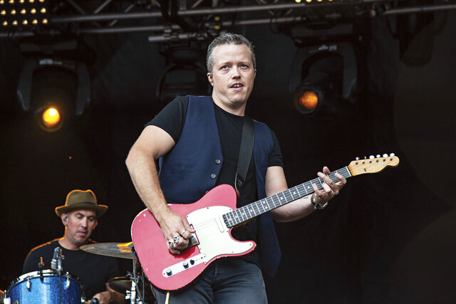 "FILE - This July 15, 2018 file photo shows Jason Isbell, of Jason Isbell & The 400 Unit, performing at Forecastle Music Festival in Louisville, Ky. Isbell is king of the Americana genre, but he's ambitious for more. The new ""Reunions"" album reaches out sonically to people who might not normally listen to that type of music, but Isbell's well-crafted songs lie at the center of what he does. (Photo by Amy Harris/Invision/AP, File)"