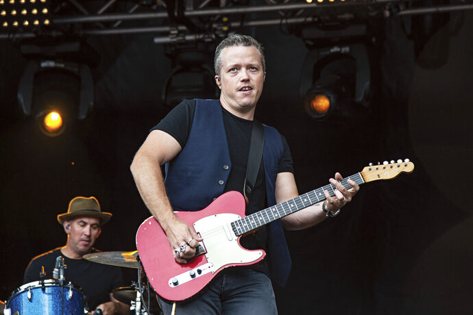 """FILE - This July 15, 2018 file photo shows Jason Isbell, of Jason Isbell & The 400 Unit, performing at Forecastle Music Festival in Louisville, Ky. Isbell is king of the Americana genre, but he's ambitious for more. The new """"Reunions"""" album reaches out sonically to people who might not normally listen to that type of music, but Isbell's well-crafted songs lie at the center of what he does. (Photo by Amy Harris/Invision/AP, File)"""