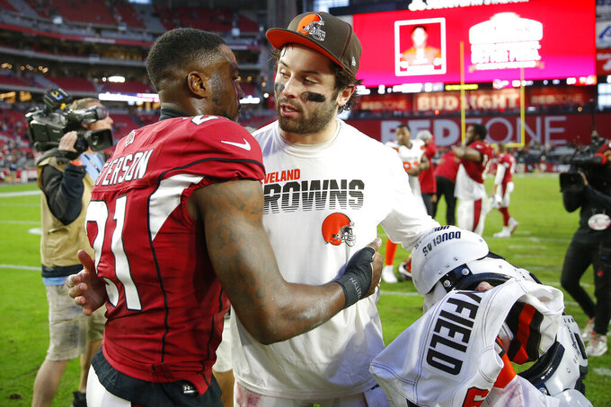 Arizona Cardinals cornerback Patrick Peterson (21) greets Cleveland Browns quarterback Baker Mayfield after an NFL football game, Sunday, Dec. 15, 2019, in Glendale, Ariz. The Cardinals won 38-24. (AP Photo/Rick Scuteri)