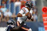 Chicago Bears quarterback Justin Fields (1) is sacked by Tennessee Titans linebacker Derick Roberson, left, in the first half of a preseason NFL football game Saturday, Aug. 28, 2021, in Nashville, Tenn. (AP Photo/Wade Payne)