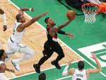 Portland Trail Blazers guard Damian Lillard (0) drives to the basket ahead of Boston Celtics center Al Horford (42) during the second half of an NBA basketball game Wednesday, Feb. 27, 2019, in Boston. (AP Photo/Mary Schwalm)